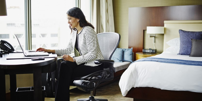 Women working in hotel room
